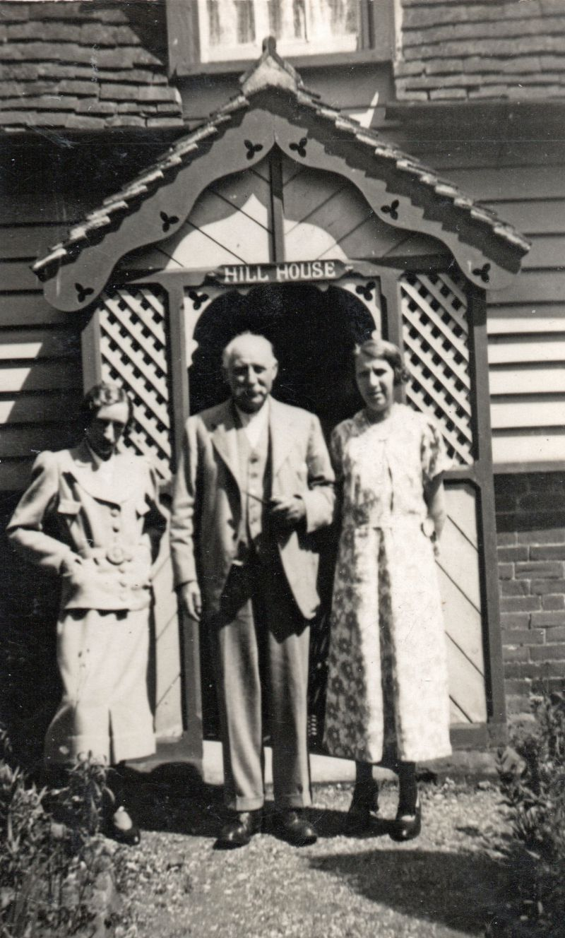 Winnie and Dora standing outside Hill House, Peldon, with their father Alfred Mason.