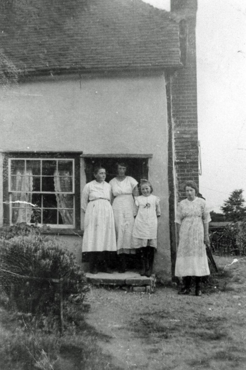 Whiting Family at Games Farm, Lower Road, Peldon. The picture is from the north west corner - door behind the family is now blocked off.