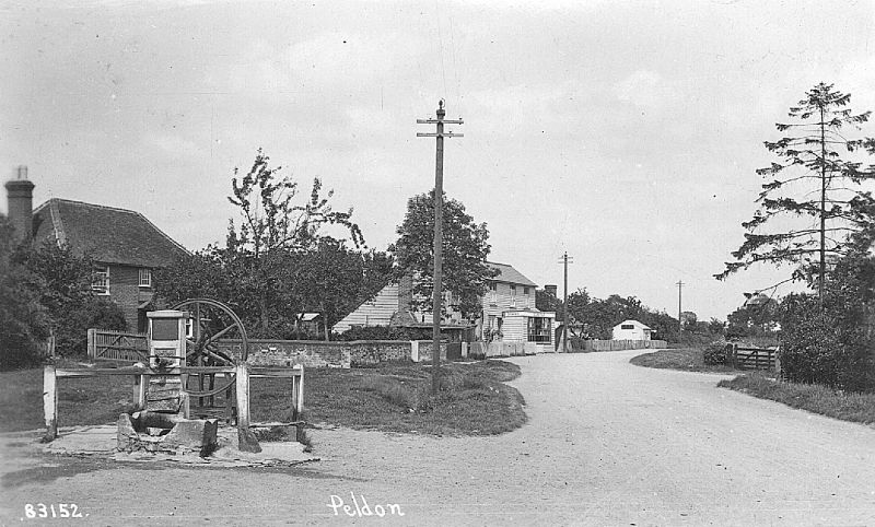 Peldon village pump and shop - looking east. Postcard 83152. 