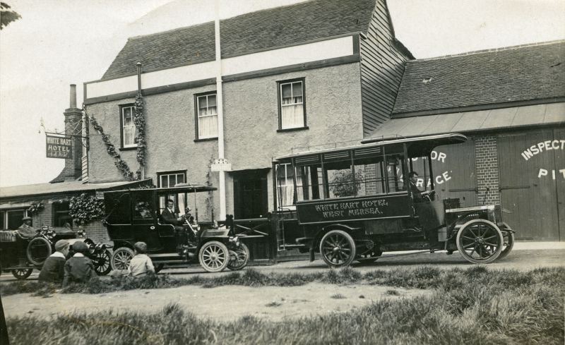 Early bus, taxi and charabanc outside the White Hart in Mersea. The landlord is A.H. Went - Arthur Went was landlord from 1895 to about 1931. 