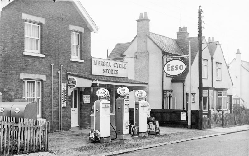 Mersea Cycle Stores - Snuffy Cornelius's shop, in Kingsland Road. Esso petrol for sale. The essential shop for catapult elastic. 2013 RST Motors. The house was built 1909 Olive Villa. 