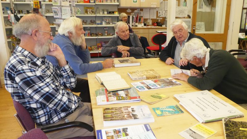 Research in the Resource Centre. L-R Tony Millatt, Mr Mortimer (Scouts), Brian Jay, Ron Green and David Cooper. Mary Neville, in the background, is listening and smiling ... 