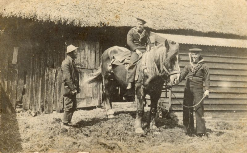 Sailors home on leave during WW1, at Haycock's Farm. Henry Hoy on the left. Archibald Percy Green on the horse. He was killed 18 October 1918 when HMS INDUSTRY was sunk in the Irish Sea.