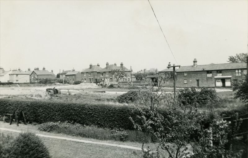Redeveloping the Coastguard Cottages site after the 1949 fire. The distant shop on the right is H.A. Keene in Churchfields. 