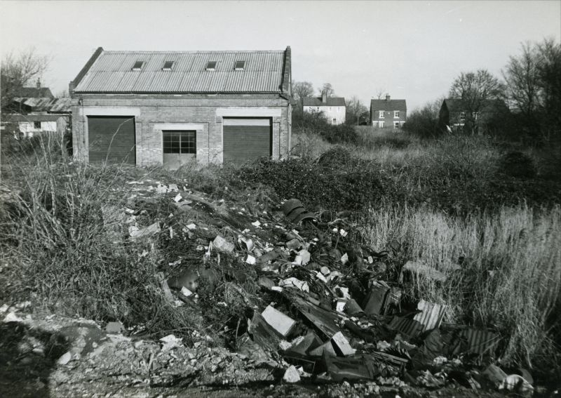Rubbish tip on the old brickworks site off Kingsland Road. Houses on Rainbow Road in the distance on the right. This is now the site of Rushmere Close. 