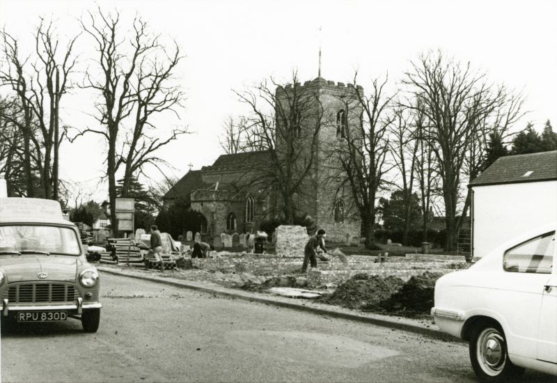 View of West Mersea Church from Church Road before the shops were erected opposite. The Mini on the left RPU830D advertises Mower Services. Botham's white shop is extreme right behind the car. 