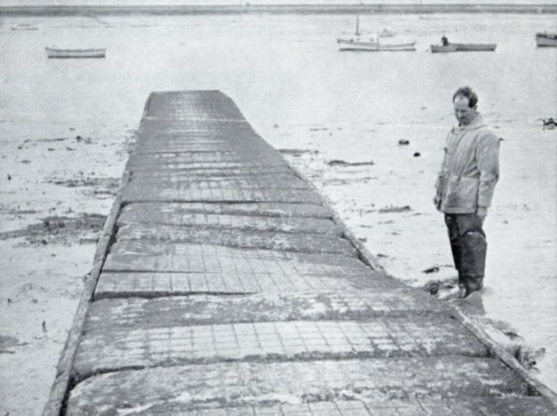 The Causeway, West Mersea Hard. Photo from Waterside Committee brochure Mersea Causeway is falling down. This causeway was replace, but bits of it can still be seen just to the south of the current causeway [ 2019 ].