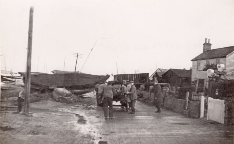 Coast Road, West Mersea after the 1953 Flood. Fred Cutts on right. 