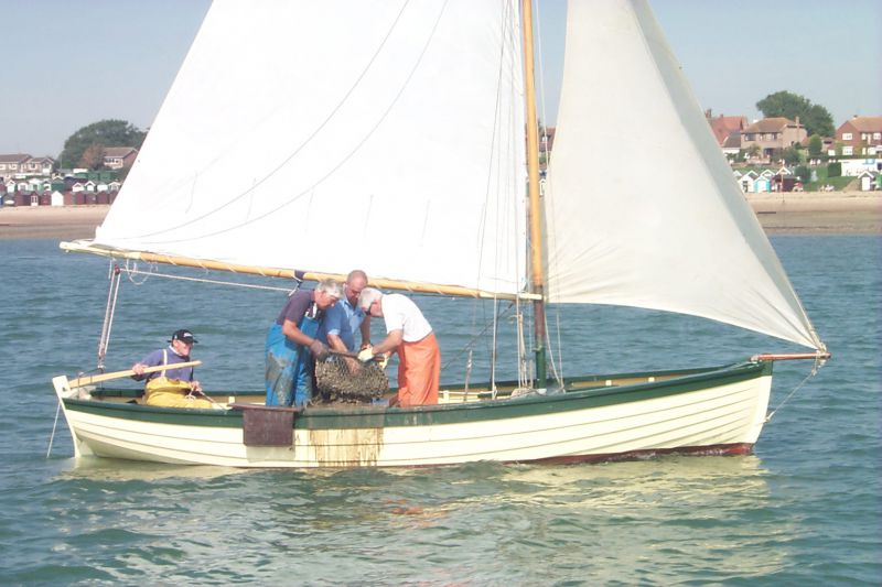John Milgate at the helm of BOY GEORGE at the 2004 Dredging Match.