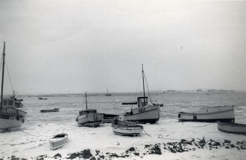 West Mersea Hard in winter of 1963. CK62 EVELYN belonging to Hec. Stoker, CK95.