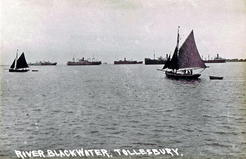 Oyster dredgers and laid up ships in the River Blackwater off Tollesbury. The vessel on the right with engines aft is thought to be the BERWINDLEA which was laid up in the River Blackwater 19 February 1932 to July 1935. Date: c1933.