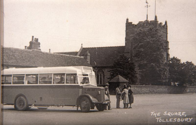 The Square, Tollesbury. Osborne's bus waiting with a Witham service, JVX806, a Bedford with a Duple wartime utility body, including wooden slatted seats. JVX 806 was new May 1945 and ended service October 1958. 