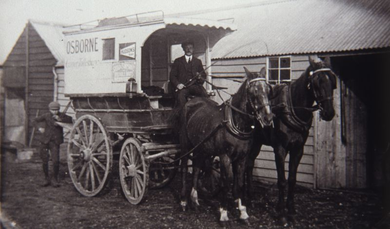G.W. Osborne proudly sits in his new horse drawn carrier cart which had full length seats each side for potential passengers.