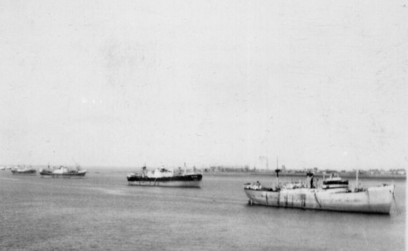 Laid up ships in the River Blackwater. OKEANIS is on the right. Date: c1958.