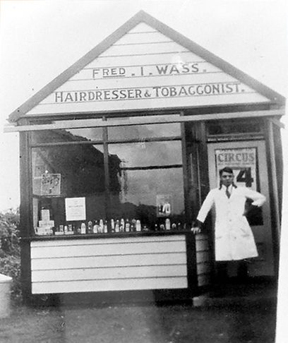 Fred I. Wass. Hairdresser and Tobacconist.