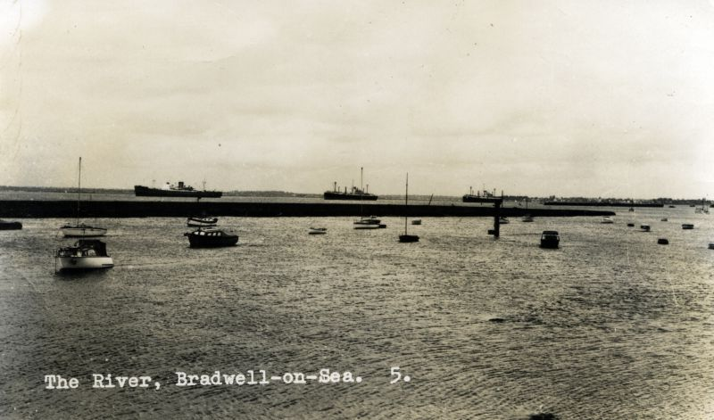 The River Blackwater from Bradwell waterfront. Laid up ships in the distance - the centre and right ships are Royal Mail Lines' DESEADO and DARRO respectively. The left ship is a Union Castle fruit ship.