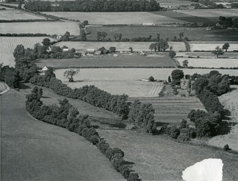 Jack Botham aerial photograph 9103A. East Mersea, by what is now Cudmore Grove Country Park. Looking northwest. Bromans Farm just above and left of centre. The prominent house right of centre is Royalties, once a pair of houses. 