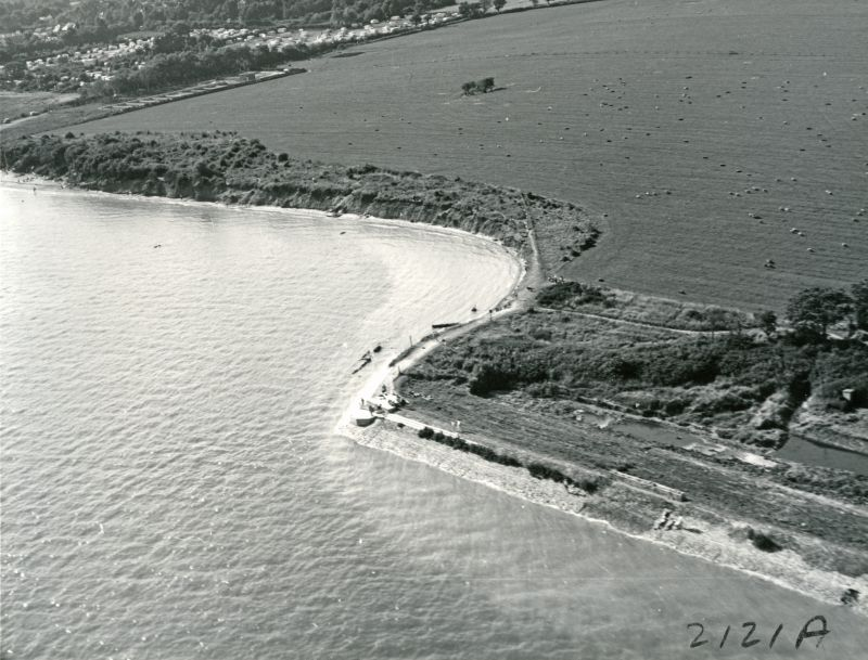 Jack Botham aerial photograph 2121A. Decoy Point and the cliffs looking towards Cross Lane and the filter beds. Pillbox just visible on Decoy Point. Waldegraves on the right. 
