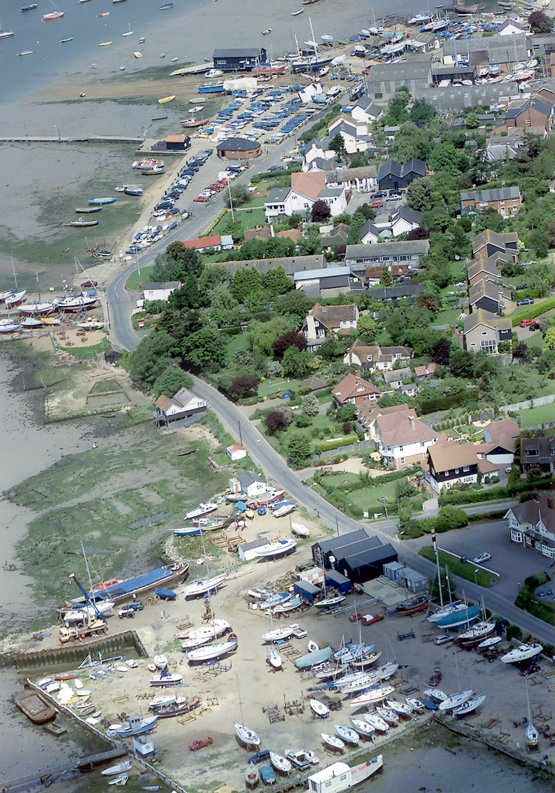 West Mersea Village Appraisal - back cover. Aerial view of Coast Road with the Victory low centre right, lifeboat shed centre top. 