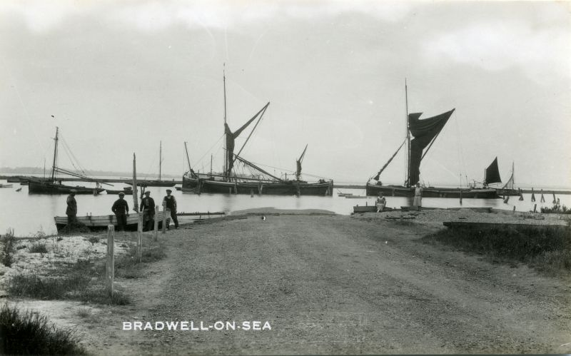 Barges at Bradwell on Sea. Barge PLANTAGENET. Smack 334CK. The laid up liner hidden beyond the barge in the centre is thought to be the ORONTES.