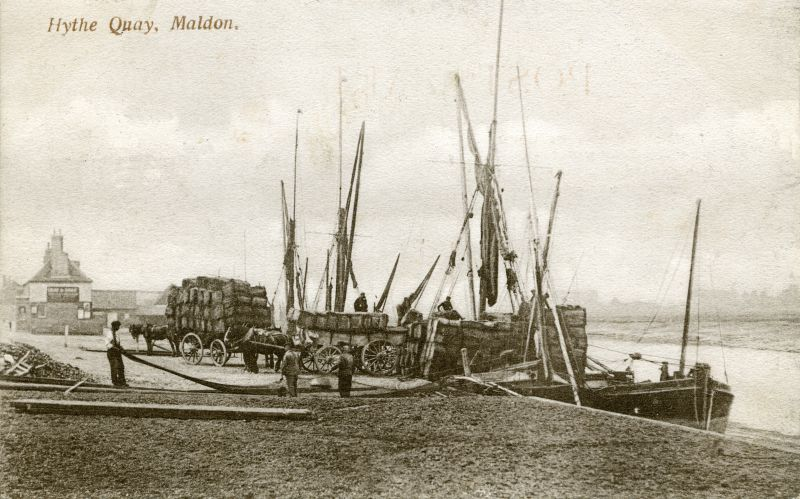 Barges at Maldon. Dressing sail on wharf. Postmarked 8 Sep 1908. 