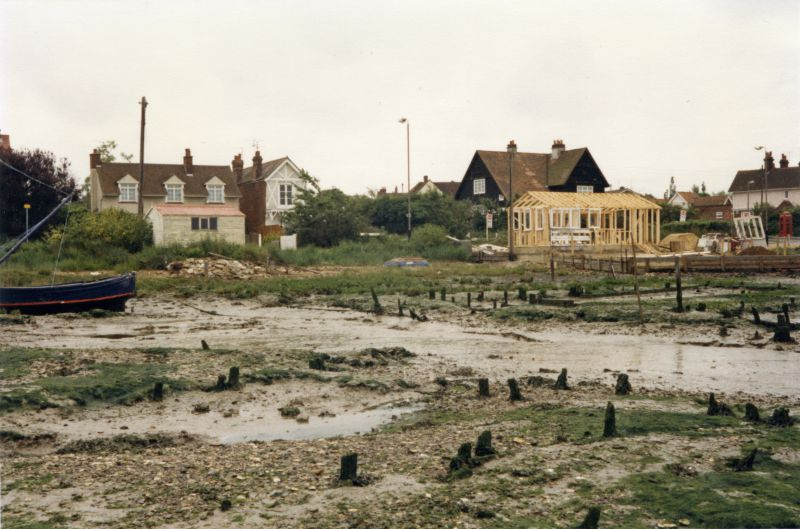 Coast road from the old oyster pits. Victory Hotel on the right. Shed under construction. 