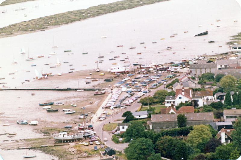 The Hard, Coast Road car park, causeway, Clarke & Carter's slipway. Hulk of PIONEER top right. 