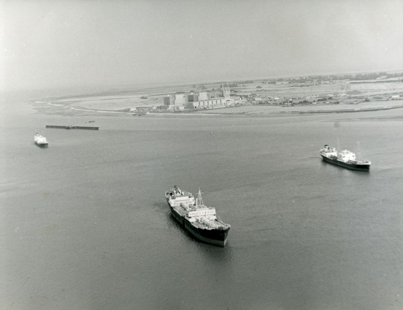 Jack Botham aerial photograph 600. Laid up ships in River Blackwater with Bradwell Power Station under construction beyond. The tanker in the foreground is thought to be the BEDFORD, 12,578 tons gross, built 1953. View looking northeast. Date: c1960.