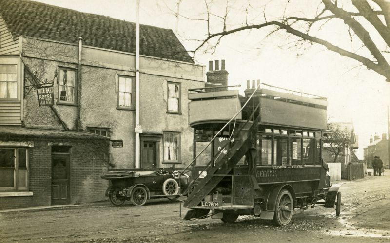 The White Hart Hotel did not always look half timbered. It is difficult to date this photograph - Berry's bus LC7804 was in service with them 1906 to July 1922. The inn sign names A.H. Went - Arthur Went kept the White Hart from November 1895 until around 1931.
