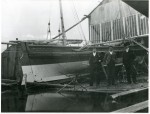 28. ID BF72_001_029_001 Rowhedge - 3 unknown men standing by Walton on Naze Volunteer Lifeboat. She is rigged for sailing and has no engine.