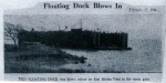 55. ID IA002680 This Floating Dock was blown ashore on Decoy Point in the recent gales. Newspaper cutting dated Feb 15, 1946.