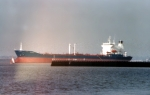 Tanker MARTITA laid up in the River Blackwater. In front of her is the barrier wall for Bradwell power station.