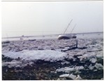 25. ID ASH095 An icy winter - West Mersea with the Packing Shed in the distance. Thought to be late 1980s.