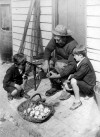 168. ID DIS2011_OYS_001 Ted Mussett sits outside Woodbine Cottage in Mersea