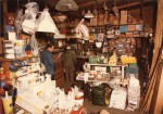 Inside Digby's shop, West Mersea. Eileen Brown behind the counter.  MF04_002_003