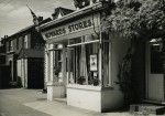 Howards Stores, run by Repton Dixon, decorated for the 1953 Coronation. On the north side of Church Road - the shop has changed, but [in 2012] the wisteria by the side of the window is still there. cJune 1953. Photo: Carol Wyatt Collection