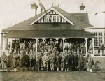 East Mersea Golf Club. Members assembling on the verandah of the clubhouse on the opening day for the full 18 hole course. 