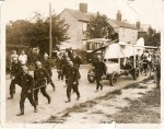 12. ID BS01_034 Mr Charles Scott's journey through the village, towed by firemen. C.W.A. Scott was an aviator who had flown to Australia. He was a Mersea resident. Picture was ...