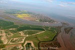 View southeast towards Mersea Island. Feldy Marshes across the centre and Salcott Creek on the right. Strood Channel and Ray Channel across the centre toward the left, with Sampsons Creek off the Ray Channel and Ray Island visible to the left.