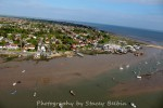 Coast Road and The Hard. Clarke & Carter's slip on the left. Sailing barge DAWN under her covers in the centre. Houseboats on the right.