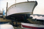 242. ID SHP_NAN_368 NANALOA in the 1980s undergoing 'routine maintenance' at West Mersea. After 1982 Pat Zierold kept her on a mooring in the Quarters.