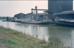 BANDICK loading grain at Colchester Hythe in the 1970s. Beyond her, extreme left, is the COLNE DREDGER.  SHP_STC_608