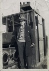 Joseph Alexander Skinner standing by the wheelhouse on the motor barge GOTHIC. He was Captain and along with the Mate, lost his life when the GOTHIC capsized off Dover December 1937.  IA003992