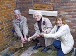 17. ID IA004072 Burying the Time Capsule at Mersea Island Museum. David Cooper, Kathleen Haines and Joanne Godfrey. The Time Capsule should be opened in 2076 - 100 years since...